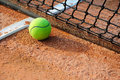 Tennis ball on a tennis court clay Royalty Free Stock Photography