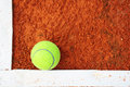 Tennis ball on a tennis court clay Stock Photos