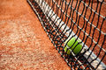 Tennis ball on a tennis court clay Royalty Free Stock Images