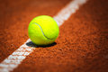 Tennis Ball on a tennis court Royalty Free Stock Photo
