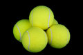 Tennis balls on black background isolated against a Royalty Free Stock Images