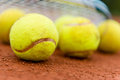 Tennis balls at the court clay with a racket Stock Image