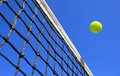 Tennis balls on court photo of a ball a Royalty Free Stock Images
