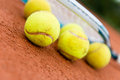 Tennis balls with racket a at the court Royalty Free Stock Image