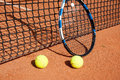 Tennis balls  and  racket  at the net Royalty Free Stock Photo