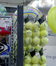 Tennis balls and racket strong in the mall picture of brand name sport equipments selling department store Stock Photos