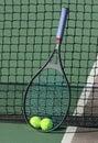 Tennis Balls/Racquet at Net Royalty Free Stock Photo