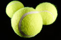 Tennis balls three isolated on black background Royalty Free Stock Images