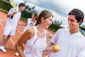Tennis couple at the court playing doubles and looking happy Stock Photos