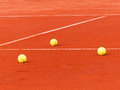 Tennis court with balls three on clay outdoor shot Stock Photo