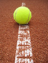 Tennis court line with ball outside in a Stock Photo