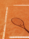 Tennis court lines racket shadow outside Stock Image