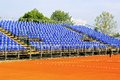 Tennis court seats new modern with blue Stock Images