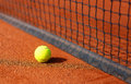 Tennis court with tennis ball and antuka background. Royalty Free Stock Photo