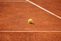 Tennis court with tennis ball a on a clay Royalty Free Stock Image