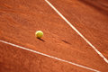 Tennis court with tennis ball a on a clay Royalty Free Stock Photo