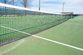 Tennis courts with blue sky and net sports green court black white Stock Images