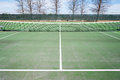 Tennis courts with blue sky and net sports green court black white Stock Image