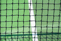 Tennis courts with close up of net sports green court and black Stock Photo