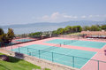Tennis courts resort in mountains overlooking lake Stock Photos
