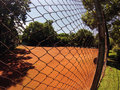 Tennis field image of a from behind a fence Stock Photography