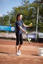 Tennis instructor teaching on a clay court Stock Photos