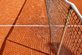 Tennis net detail on clay court Royalty Free Stock Photo