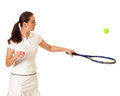 Tennis player adult woman playing studio shot over white Stock Image