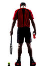 Tennis player drinking energy drinks silhouette one young man in isolated on white background Royalty Free Stock Photography