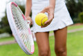 Tennis player hitting the ball close up of a with racket Royalty Free Stock Photos
