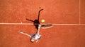 Tennis Player Hitting Ball On ...