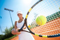 Tennis player hitting the ball young sporty female Royalty Free Stock Image