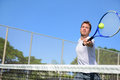 Tennis player man hitting ball in a volley male sport fitness athlete playing on outdoors hard court summer healthy Stock Photo