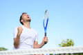 Tennis player man winning cheering victory celebrating winner happy in celebration of success and win fit male athlete on Royalty Free Stock Photos