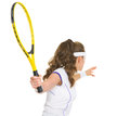 Tennis player ready to hit ball. rear view Stock Image
