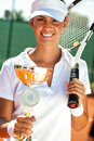 Tennis player showing golden goblet young female Royalty Free Stock Images