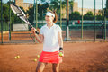 Tennis player, sportswoman on clay court with racquet and balls. lifestyle with sport and practice concept Royalty Free Stock Photo