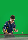 Tennis player young man in play on chroma key Stock Photo