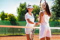 Tennis players giving handshake women handshaking after playing a match Stock Images