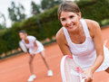 Tennis players playing doubles female and looking happy Stock Photos