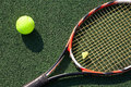 Tennis racket with a ball Stock Images