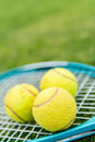 Tennis racket with ball balls at the court Royalty Free Stock Images