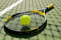 Tennis Racket and Ball on Court Royalty Free Stock Photo