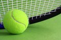 Tennis racket ball green background Stock Image