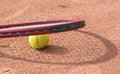 Tennis racket and balls on the clay court close up view of Royalty Free Stock Photography