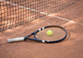 Tennis racket and balls on the clay court close up view of Stock Photography