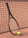 Tennis racket and balls on the clay court close up view of Stock Image
