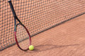 Tennis racket and balls on the clay court close up view of Stock Photo