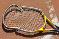 Tennis racket crashed rackey in the court Stock Images