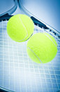 Tennis racket and two balls Stock Image